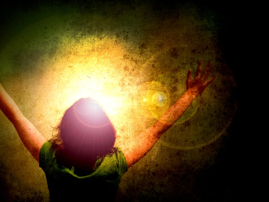 Worshipper worshipping in the light of Christ